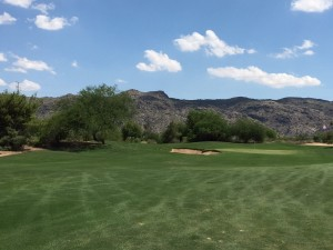 The Par 4 3rd hole turns right into a view of South Mountain.